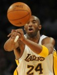 Kobe Bryant of the Lakers passing the ball.