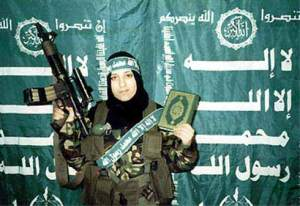 A female Hamas suicide bomber poses with the Qur'an before detonating herself and killing four Israelis.