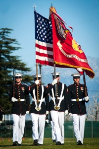 The U.S. Marine Corps Color Guard marches during pass in review during the closing of a Battle Color Detachment ceremony at Eisenhower High School, Rialto, Calif., on March 4, 2012.