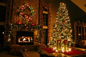 Beautiful Christmas tree - wreath on the fireplace, table with candles: warmly lit home